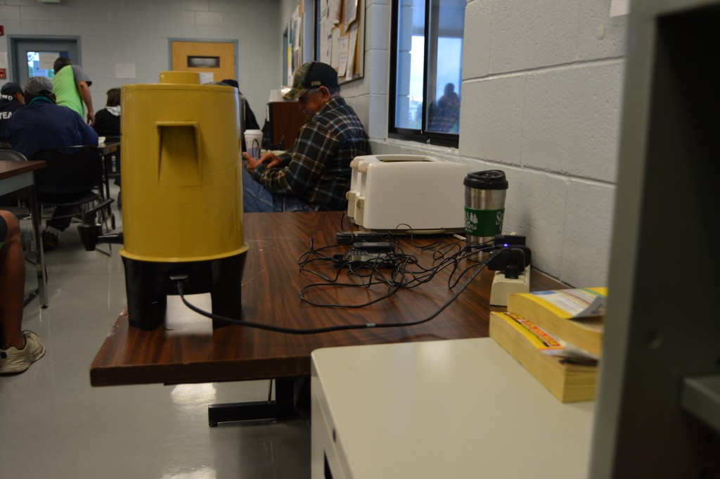 Workers can charge their cell phones and have a cup of coffee while waiting for work. – Photo by Michael Olinger
