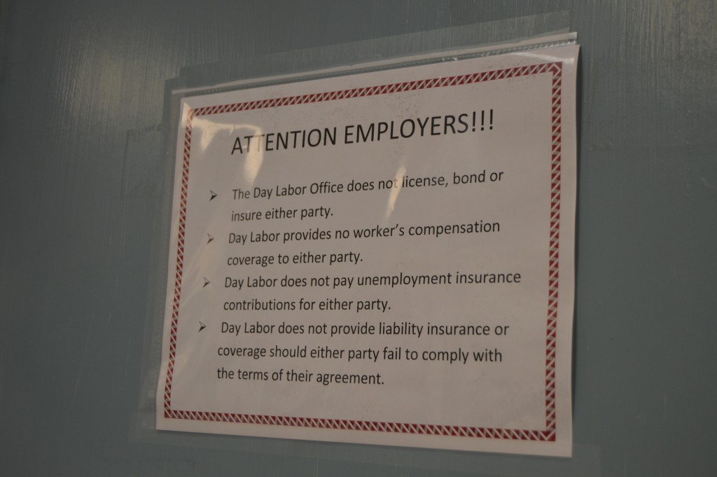 A sign adorning the exit to the Day Labor Office informs employers of their rights and liabilities. – Photo by Michael Olinger.