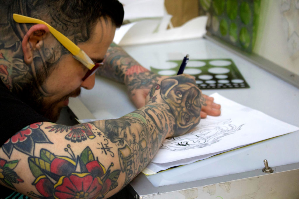 Albert Rivas sketching a tattoo