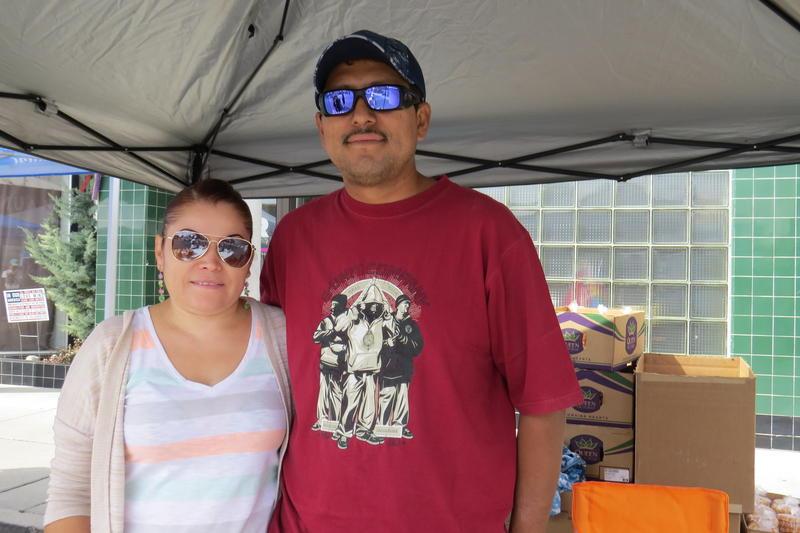 Mayra and Alberto Villa selling Buñuelos and ribbon fries at Fiesta on Wells. CREDIT: Natalie Van Hoozer