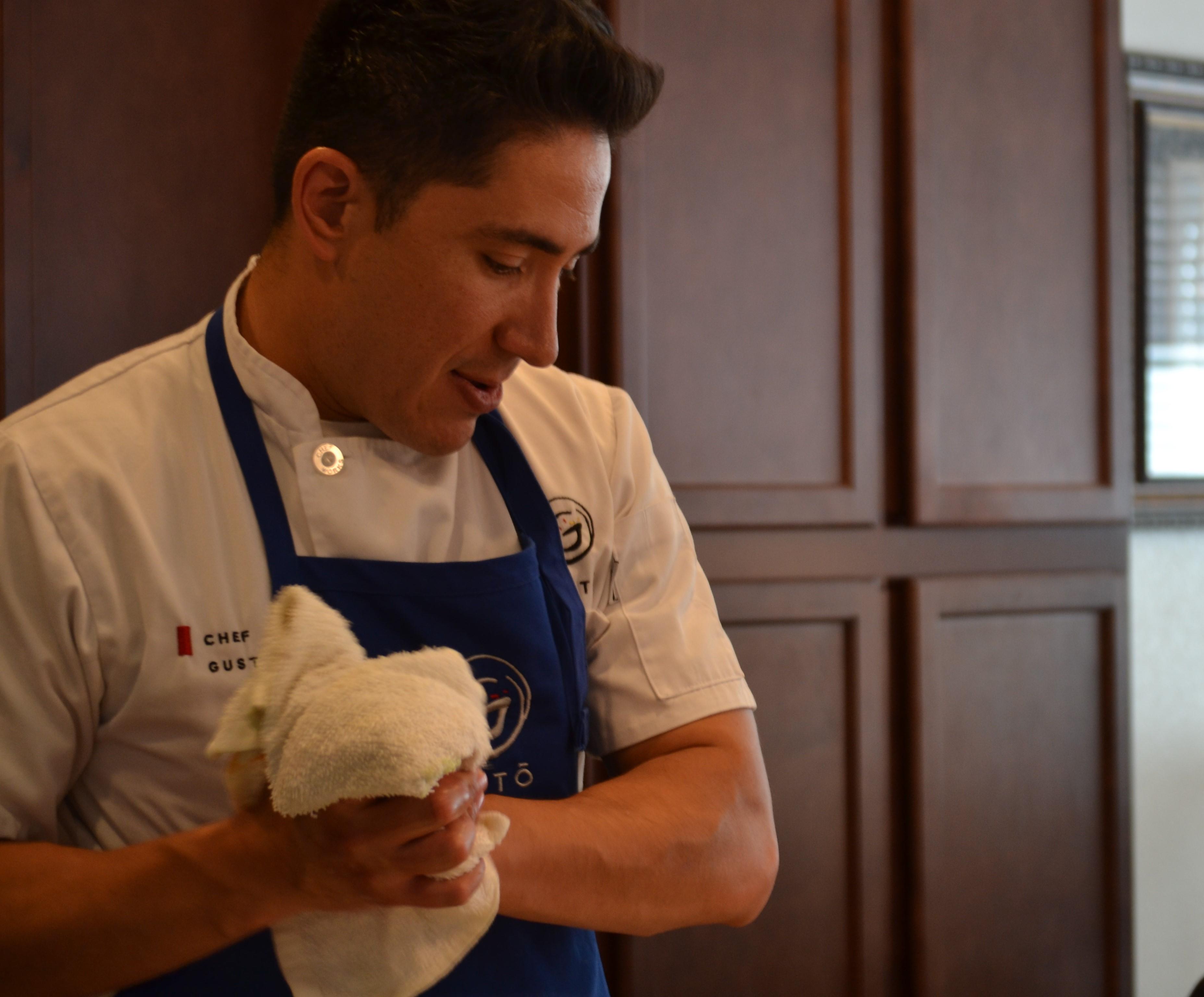Gustavo Velasco Jara, wiping his hands and admiring his work.
