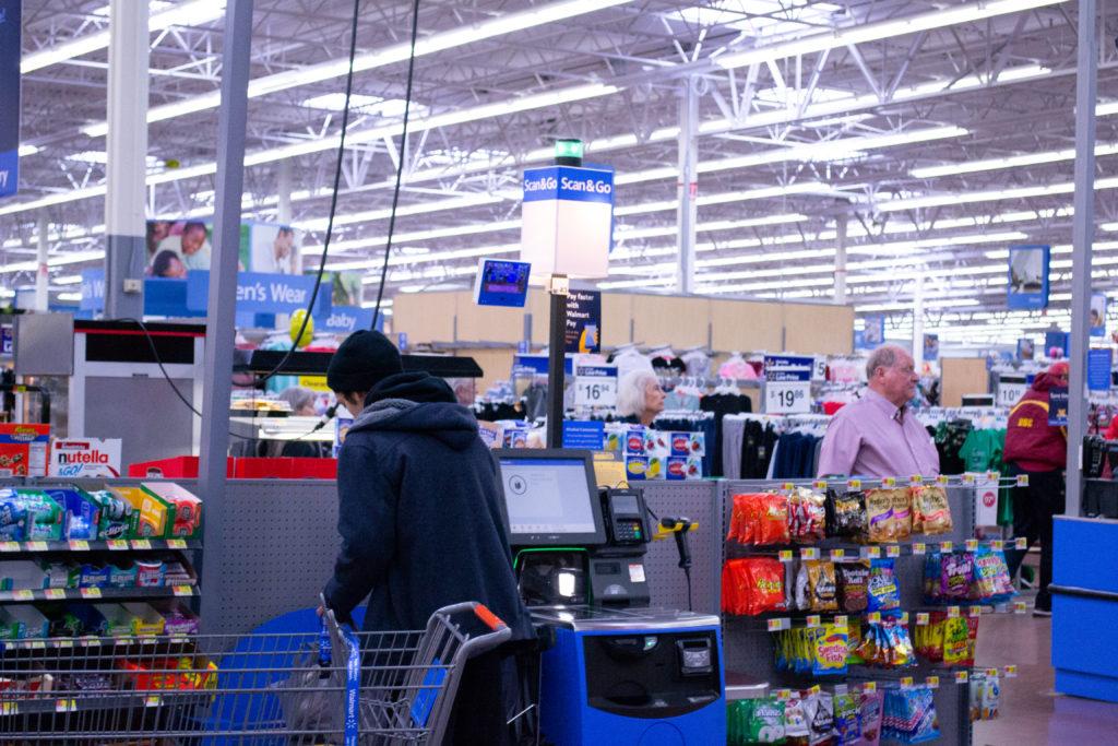 Man checking out at Walmart