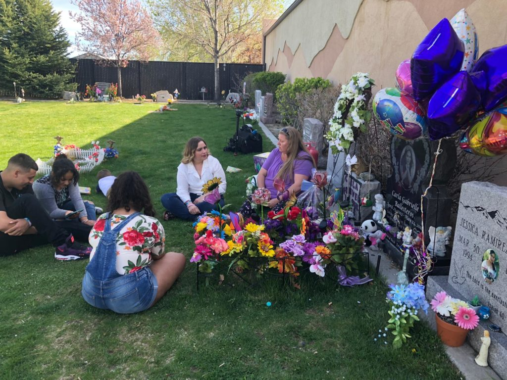 Family sits at gravesite