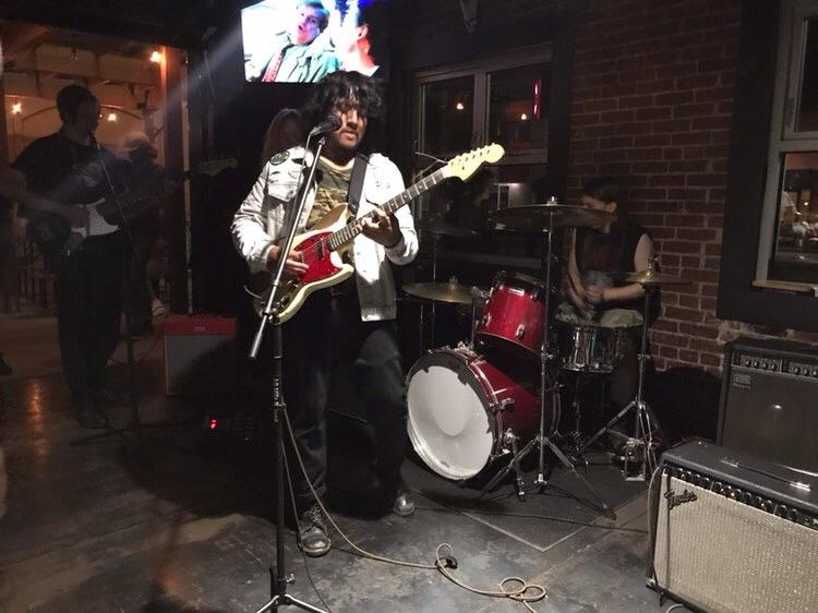 Christopher Monzon, former UNR student playing guitar at 40 Mile Saloon, in Reno, Nevada.