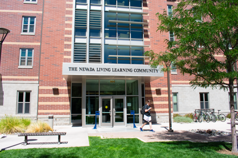 """Front entrance of the dorm hall, """"Nevada Living Learning Community."""""""
