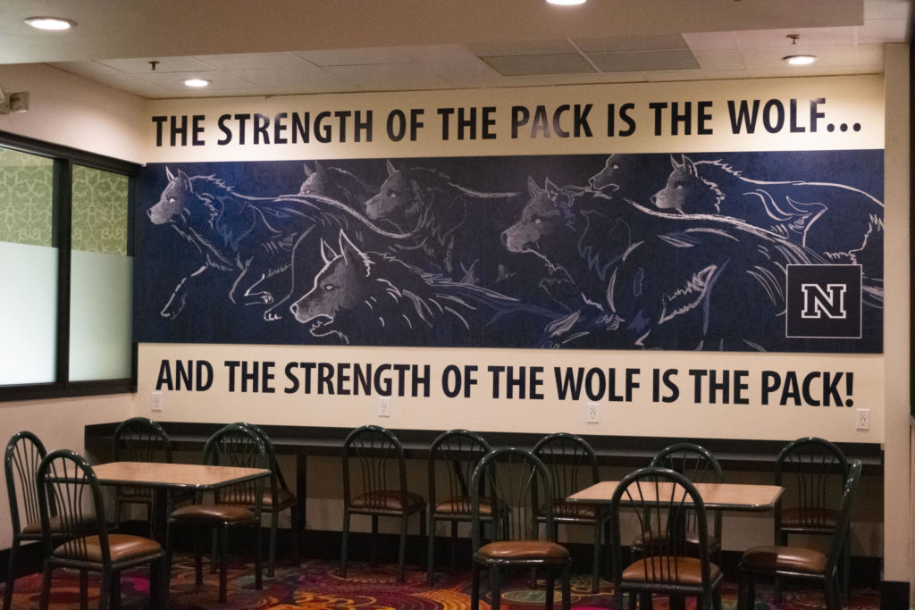 A painted mural on the wall depicting wolves running.