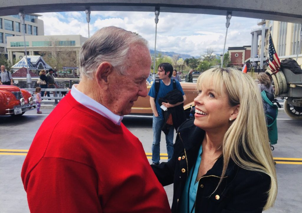 Previous Reno Mayor, Robert Cashell and current Reno mayor, Hillary Schieve talking at a local parade.