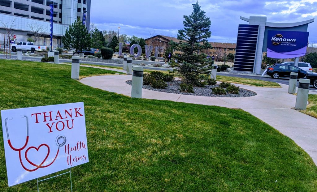 "Sign saying ""Thank you, health heroes,"" outside Renown Hospital."