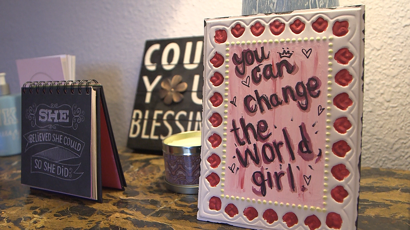 Images of affirmations on Olga's nightstand