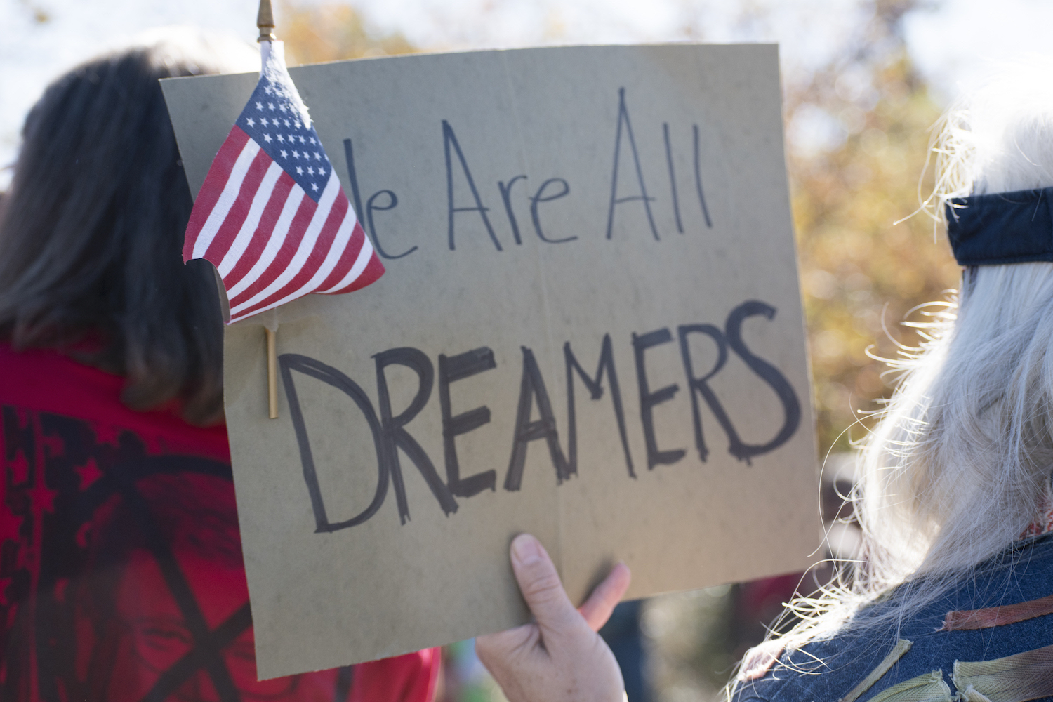 A sign held by a demonstrator at a 2017 protest in support of DACA in Reno, Nevada reads: We Are All Dreamers