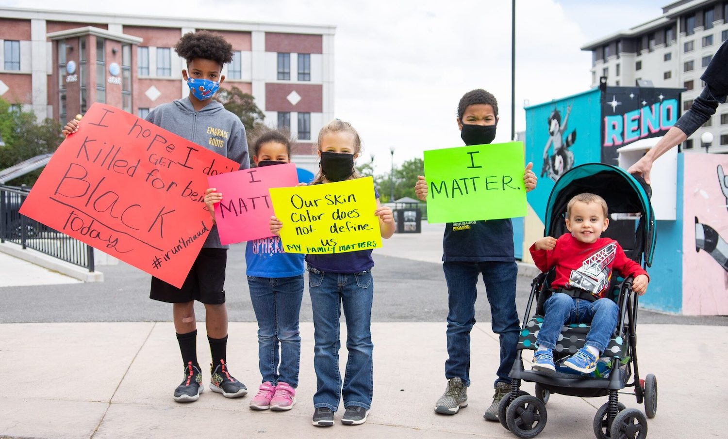 Kids in Reno hold up signs to protest police brutality