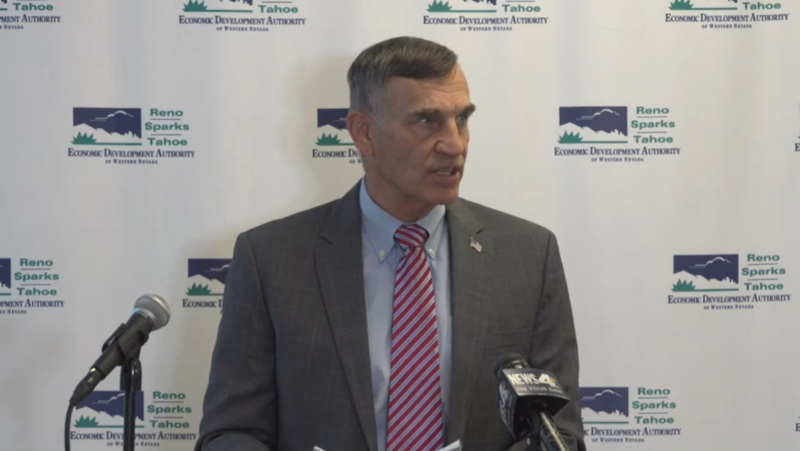 President and CEO of EDAWN Mike Kazmierski at podium during a press conference