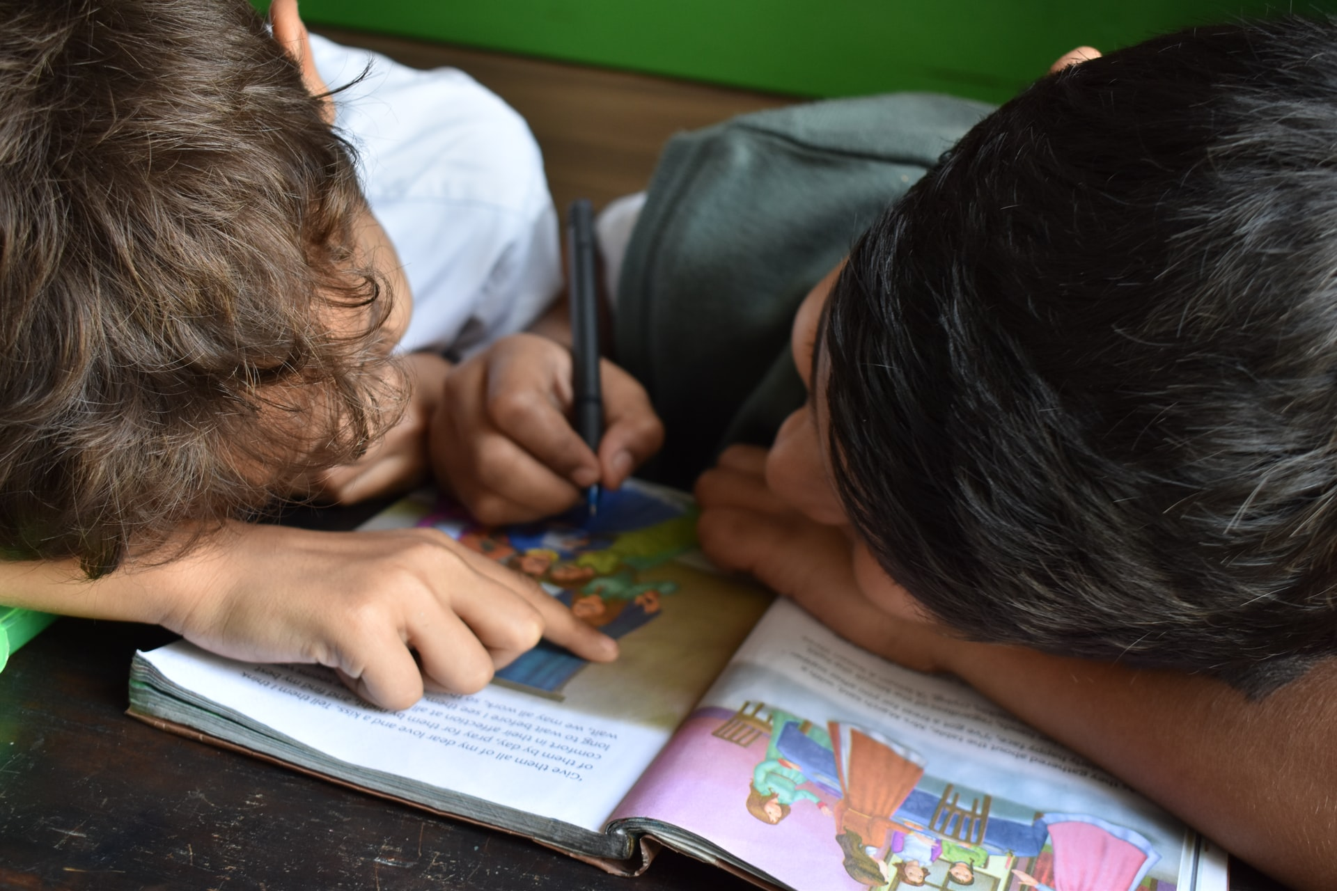 Young boys working on reading homework.
