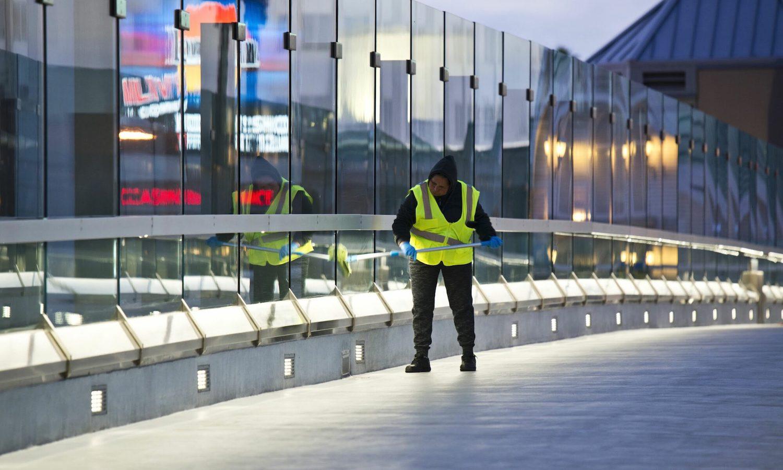 Worker cleans skyway on Las Vegas Strip.