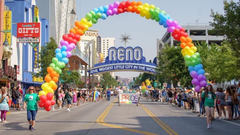 Photo of Reno Arch, framed by multicolor balloons, during the gay pride parade