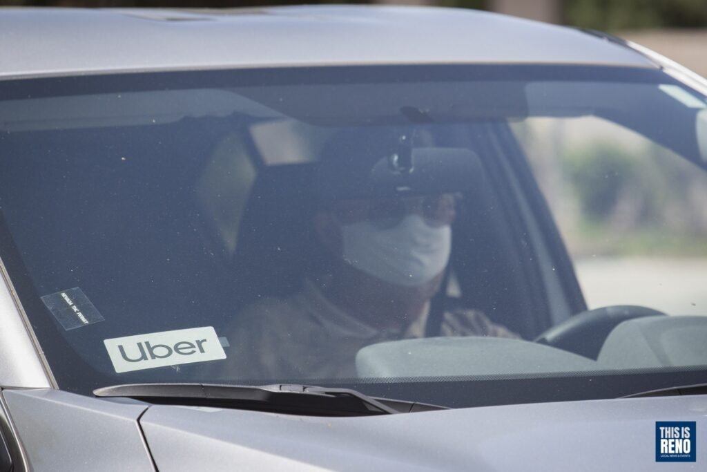 An Uber driver wearing a mask while working.