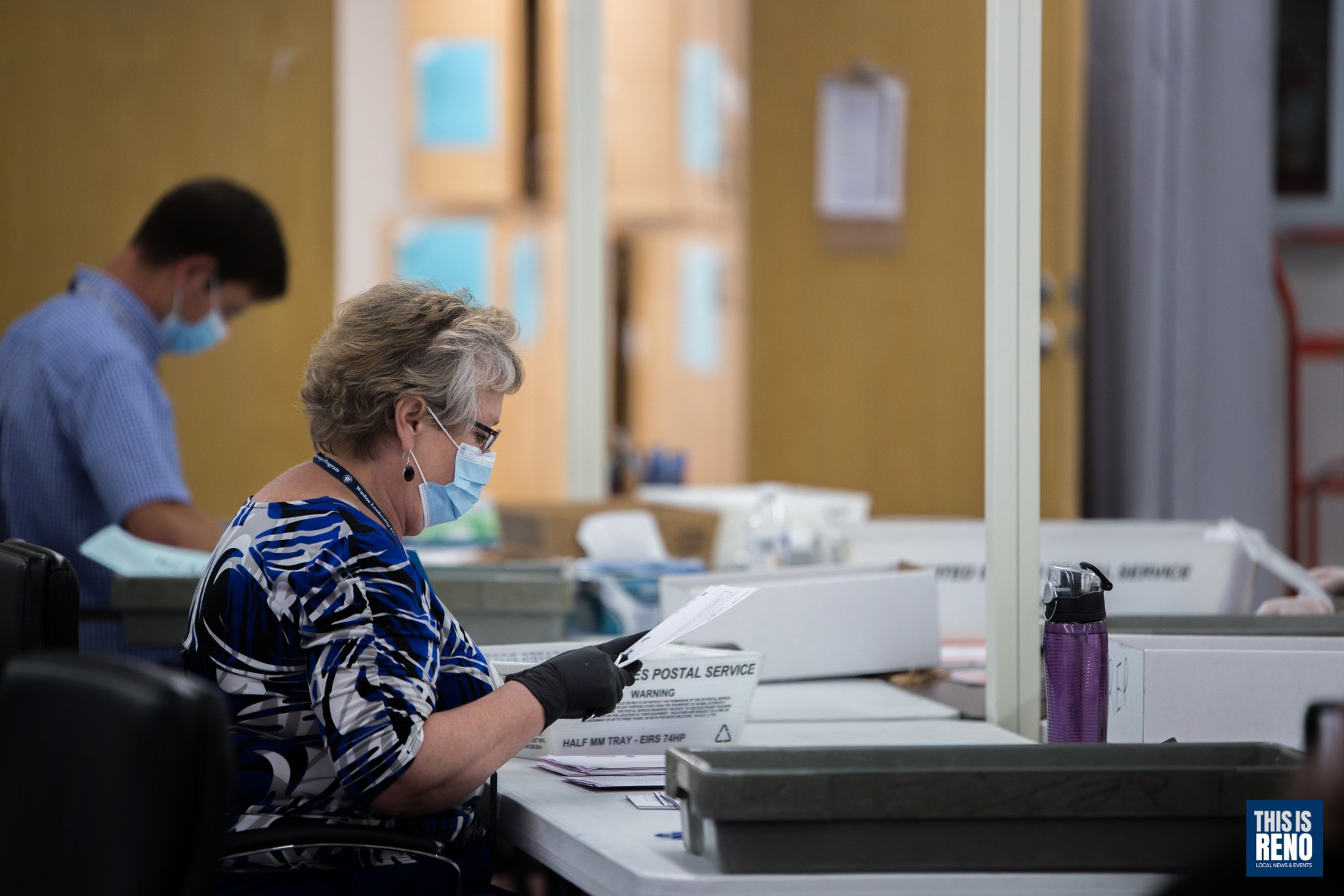 A Washoe County employee counts June 2020 primary election ballots.