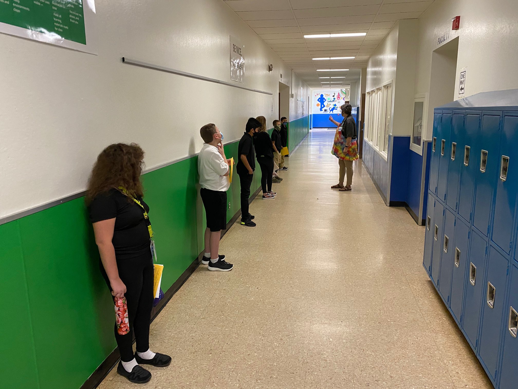 Students from a Washoe County elementary school waiting in school hallway to enter class.