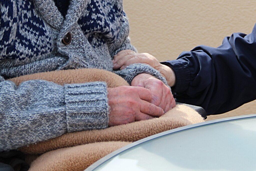 hands of senior citizens on lap
