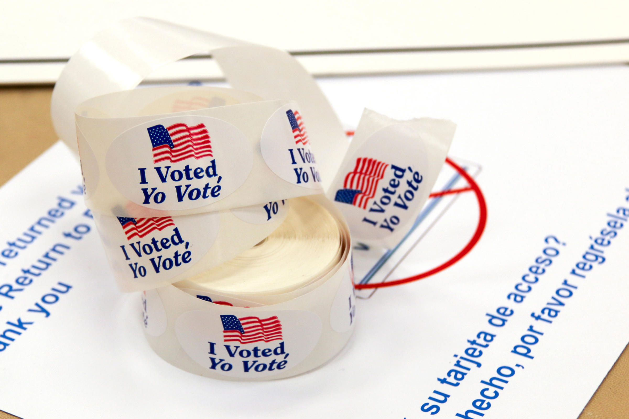 "A large roll of ""I voted"" stickers sitting on top of a table."