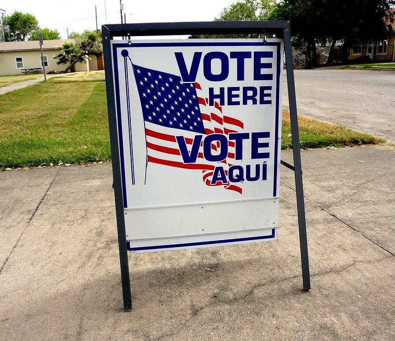 "Image shows a freestanding ""I voted"" sign placed on the sidewalk."
