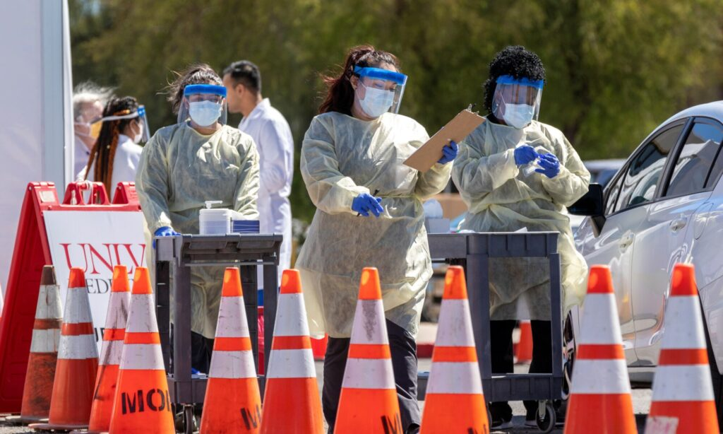 Clinical Pathology Laboratories employees gather samples during the UNLV Medicine Drive-Through Testing Clinics.