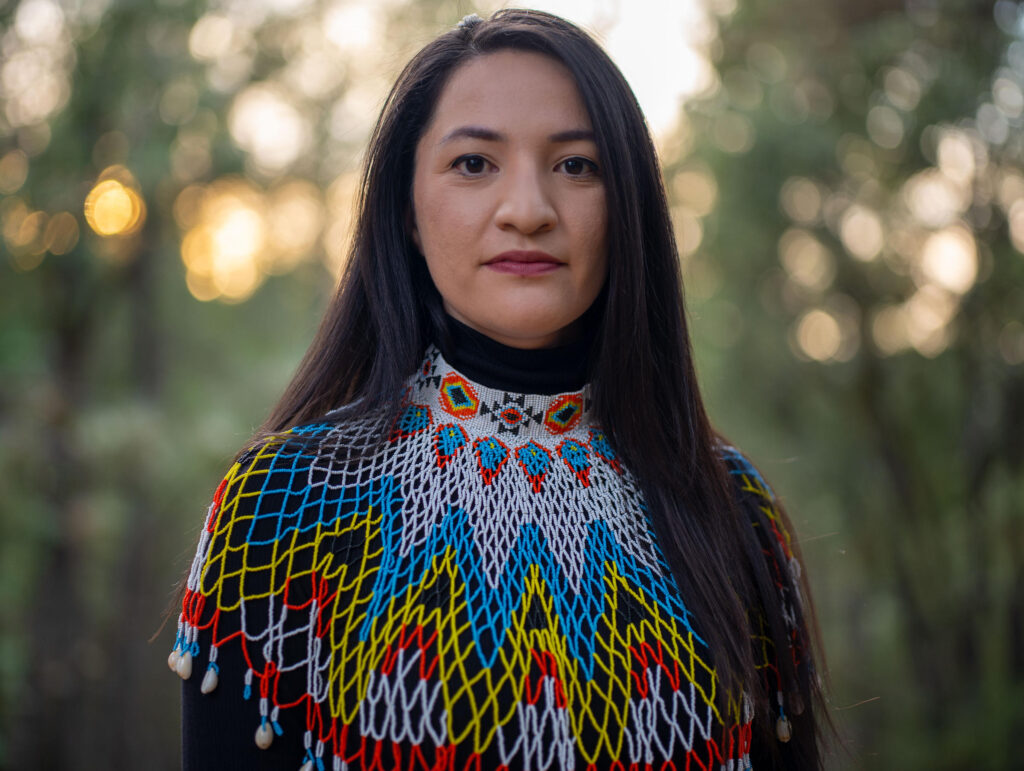 Tsanavi Spoonhunter stands in a beaded collar made by her mother.