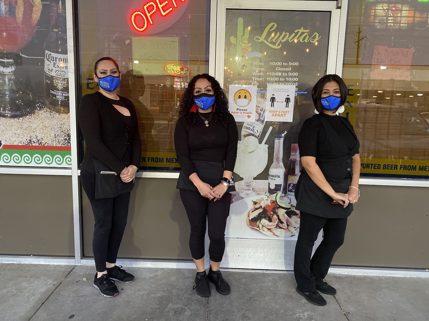 """Employee's of Lupita's Mexican Restaurant in Sparks wear """"Pongamos de Nuestra Parte"""" masks."""