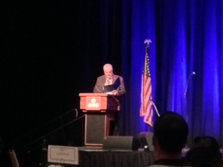 Gov. Steve Sisolak at podium on stage
