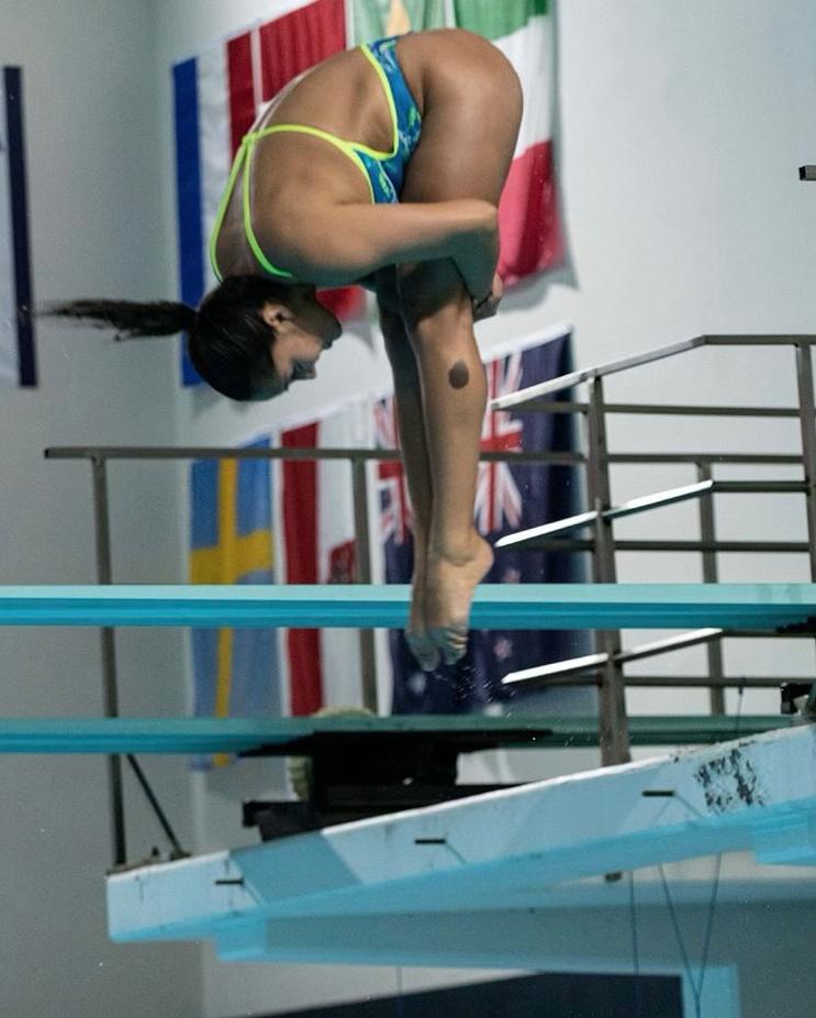 Isabel Vazquez leaps off a diving board