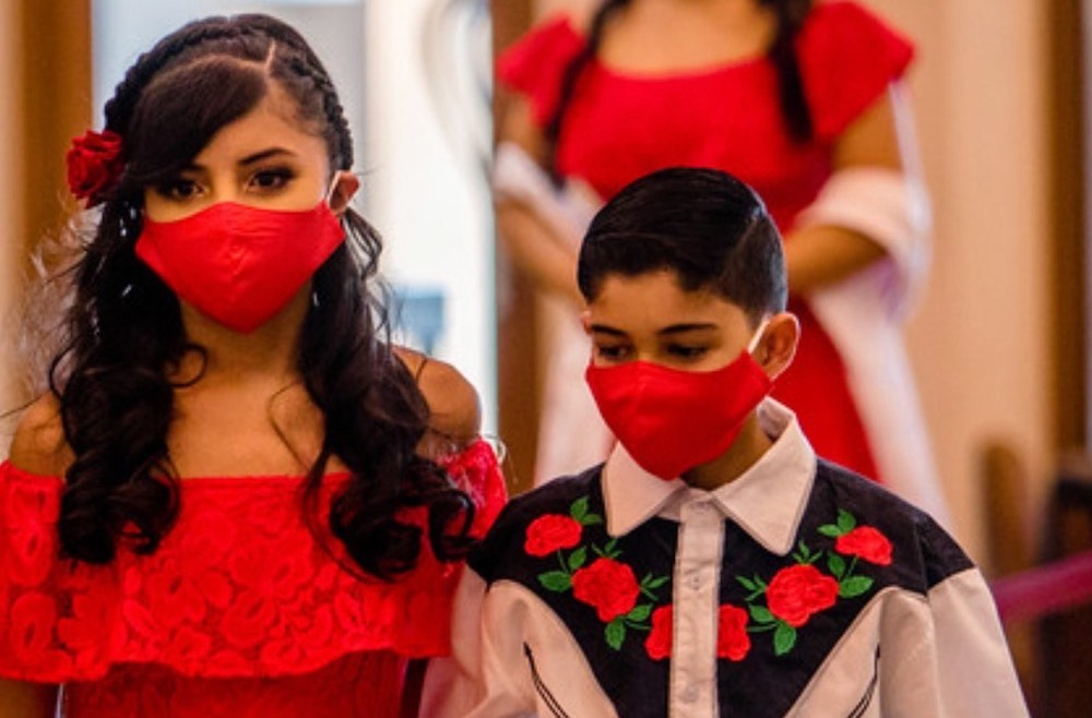 young girl and boy wearing red masks