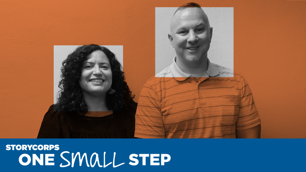 A woman and man who met at a One Small Step conversation stand alongside each other and look at camera smiling. The StoryCorps and One Small Step logos are layered on top of the photo.